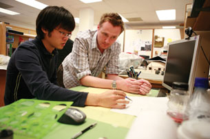 Architecture student J.C. Choi and landscape professor Carl Smith discuss design