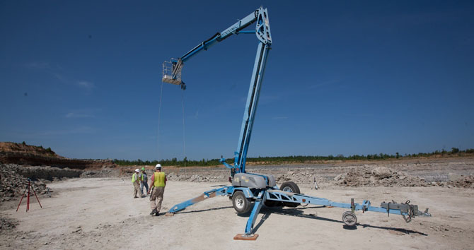 Researchers for the Center for Advanced Spatial Technologies used a laser scanner placed on a cherry picker to create high-resolution images of the dinosaur tracks imprinted at the site.