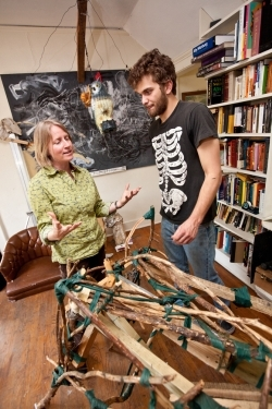 Faculty mentor Kristin Musgnug discusses a sculpture-in-progress with Luke Knox.
