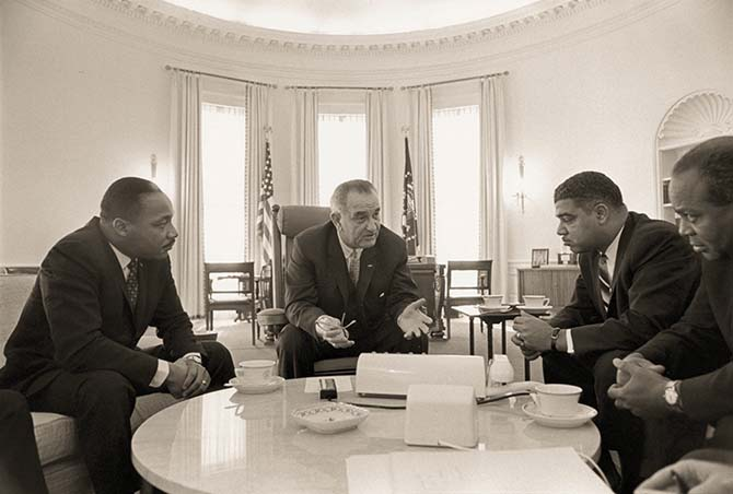 President Lyndon B. Johnson meets with Civil Rights leaders in 1964 in the Oval Office. (L-R) Martin Luther King Jr., President Lyndon B. Johnson, Whitney Young and James Farmer. (Roy Wilkins and Lee White were also present but do not appear in this frame.)
