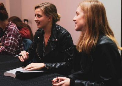 Jenn and Chessy signing books