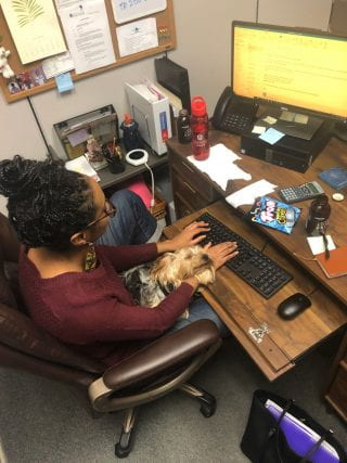 Brittany Hearne typing at her desk