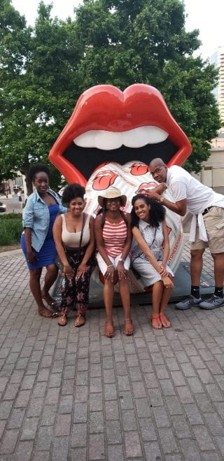 Brittany Hearne and friends in front of big lips
