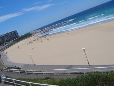 Photo of beach scene, taken at skewed angle.