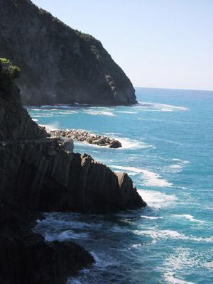 Landscape view of cliffs beside an ocean.