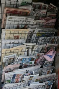 A packed newspaper stand is shown