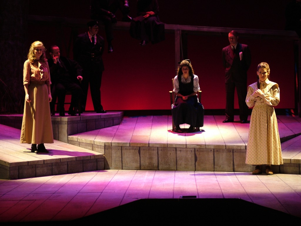 Elizabeth France (seated, center) in the 2004 UA production of Parade, a musical about a 1913 murder trial.