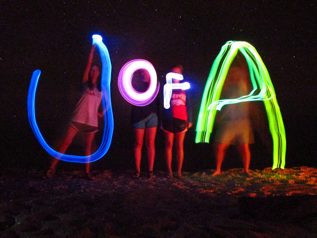 """long exposure shot at night that spells out """"U of A"""""""