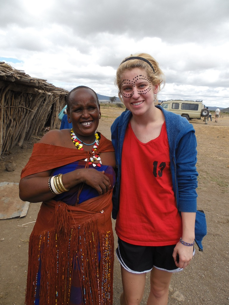 Girl poses with Datoga woman