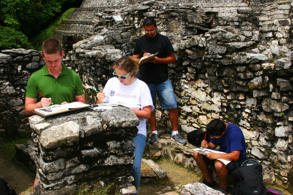 A typical day travelling through Mexico:  the group nestled among ancient ruins trying to capture the essence of the place through precise but expressive pen and ink drawings.