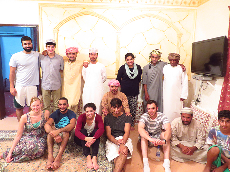My classmates and I with our hosts in Oman - web