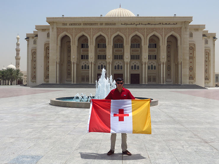 Myself and my fraternity's flag (Kappa Alpha Order) in front of the main administrative building at the American Univeristy of Sharjah-web