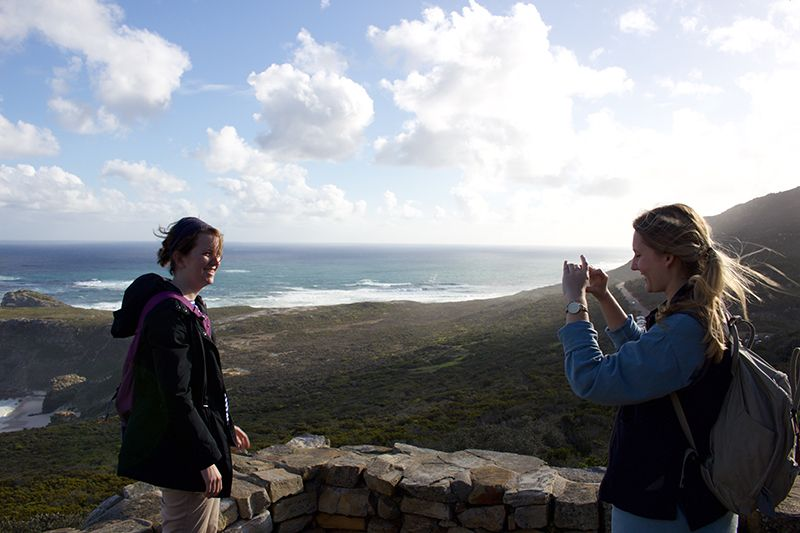Rebecca snaps a shot of Chelsea at Cape Point.