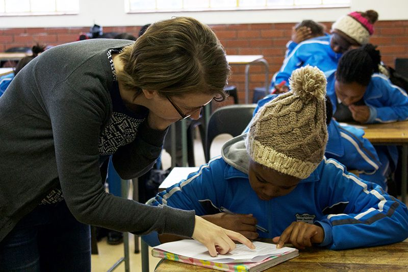 Chelsea assists a student taking a survey.