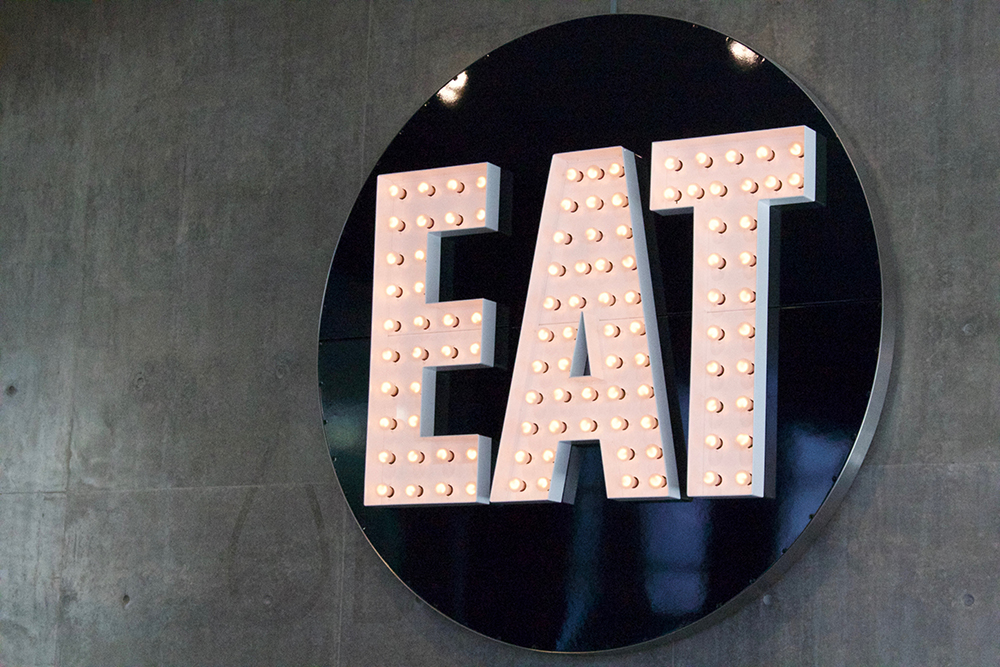 Large sign with EAT lighted up.