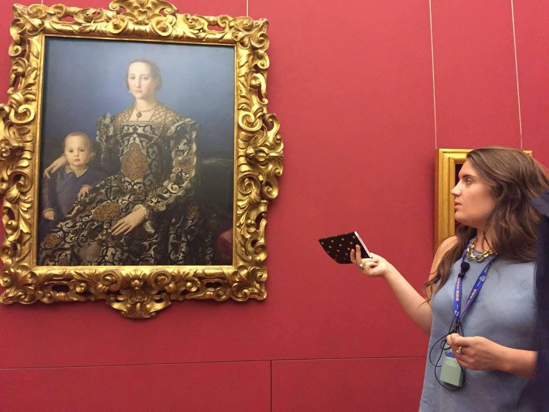 Female student discusses portrait.