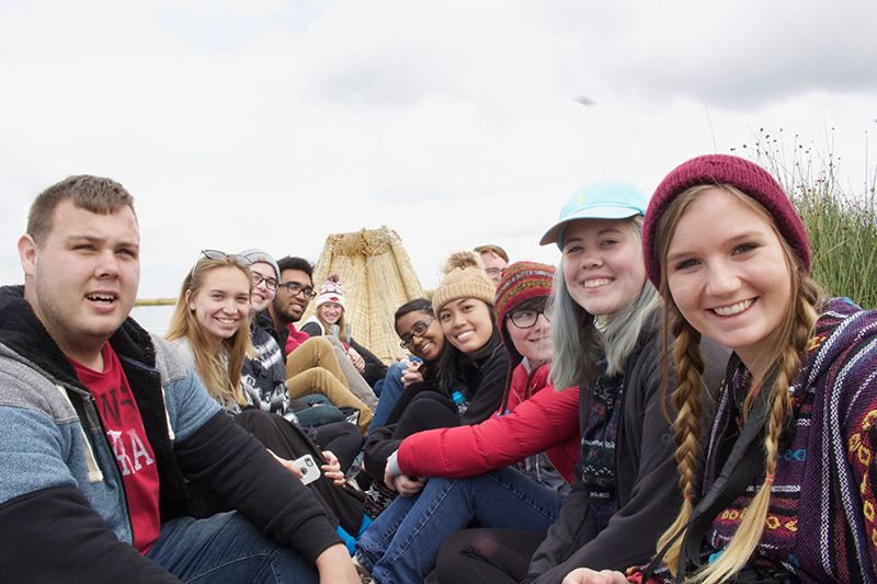 group shot of students on a reed boat.