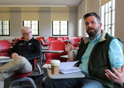 "2. Introductions followed, with students and area professionals sharing ""what you need to know about me."" Dan Miller, right, development director for the Salvation Army NWA, asked: ""How can we create a dignified, loving place? A stable environment that builds people up and changes their outlook, even a little bit? We want to encourage community and love."" Sociology professor Kevin Fitzpatrick, left, also works on the front lines to help homeless people in Northwest Arkansas."