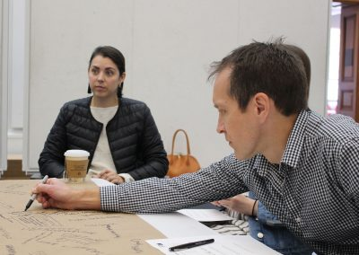 4. Noah Billig, a landscape architecture professor who serves as honors program director for Fay Jones School of Architecture and Design, has led studios on design advocacy. Here, he brainstorms with students and Seven Hills CEO Jessica Andrews.
