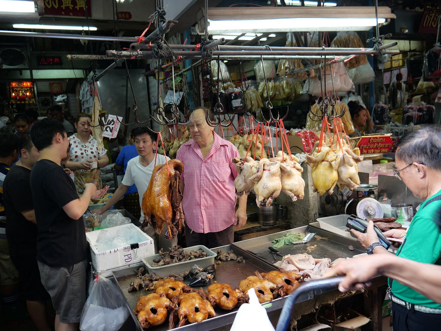 Photo of duck and chicken stalls at wet market in Bangkok, Thailand.