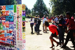 The university community pulled down the wall Friday.