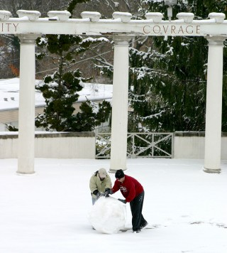 students making a snowman in the greek theatre