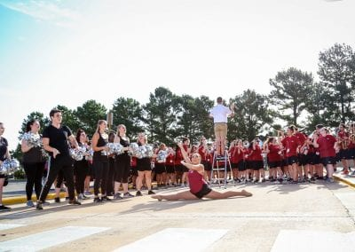 UARK Marching Band performing outside of Hotz Honors Hall