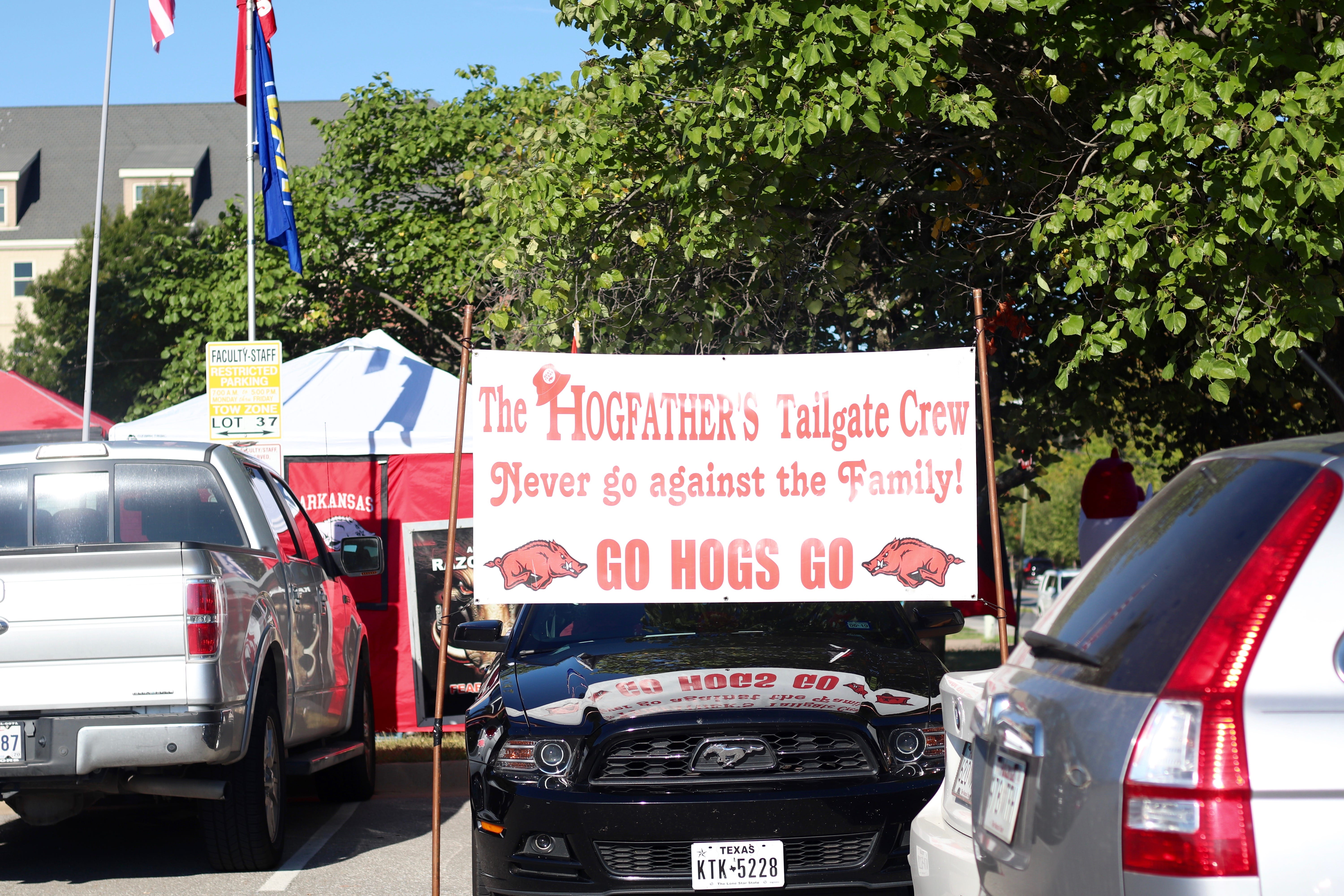 """A tailgate sign that reads """"The Hogfathers Tailgate Crew, Never go against the Family, Go Hogs Go!"""""""