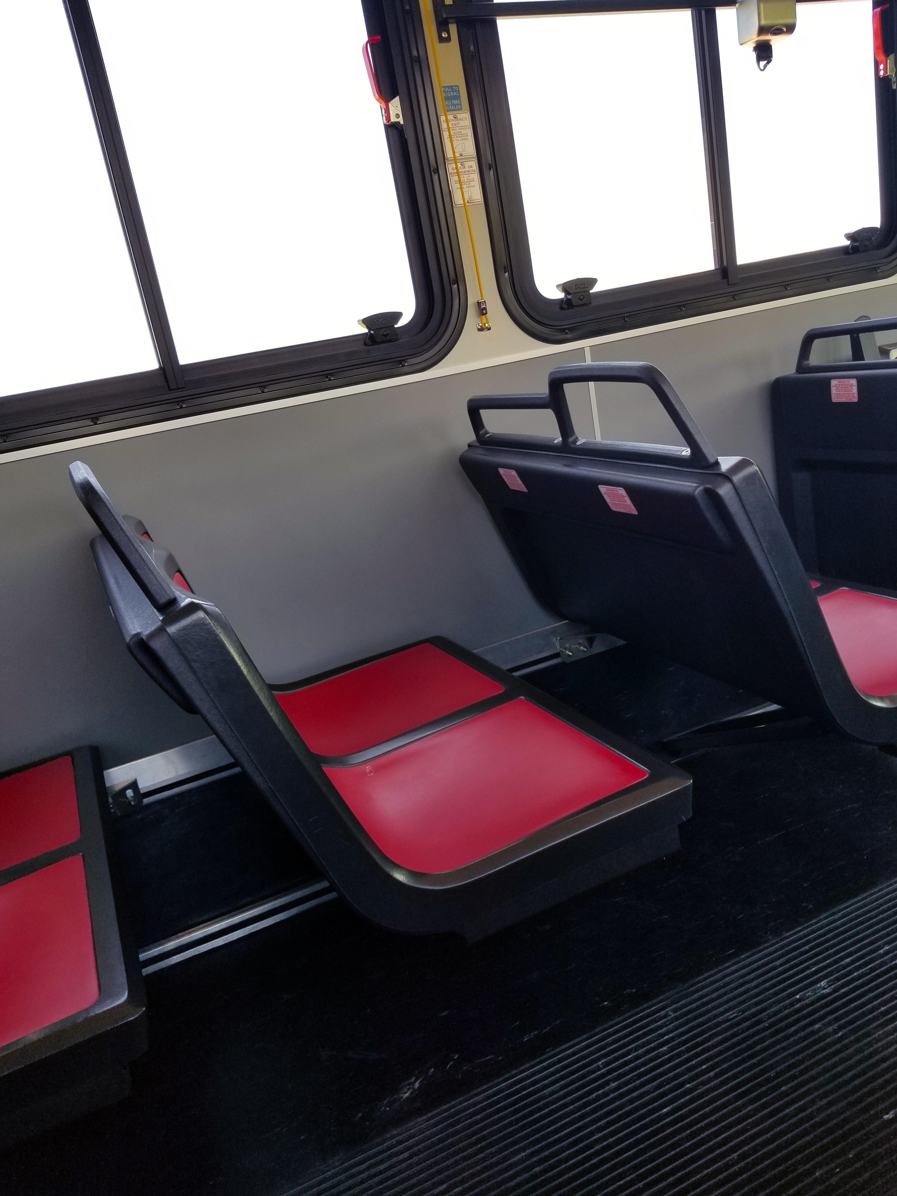 Black and red seats inside the Razorback Transit
