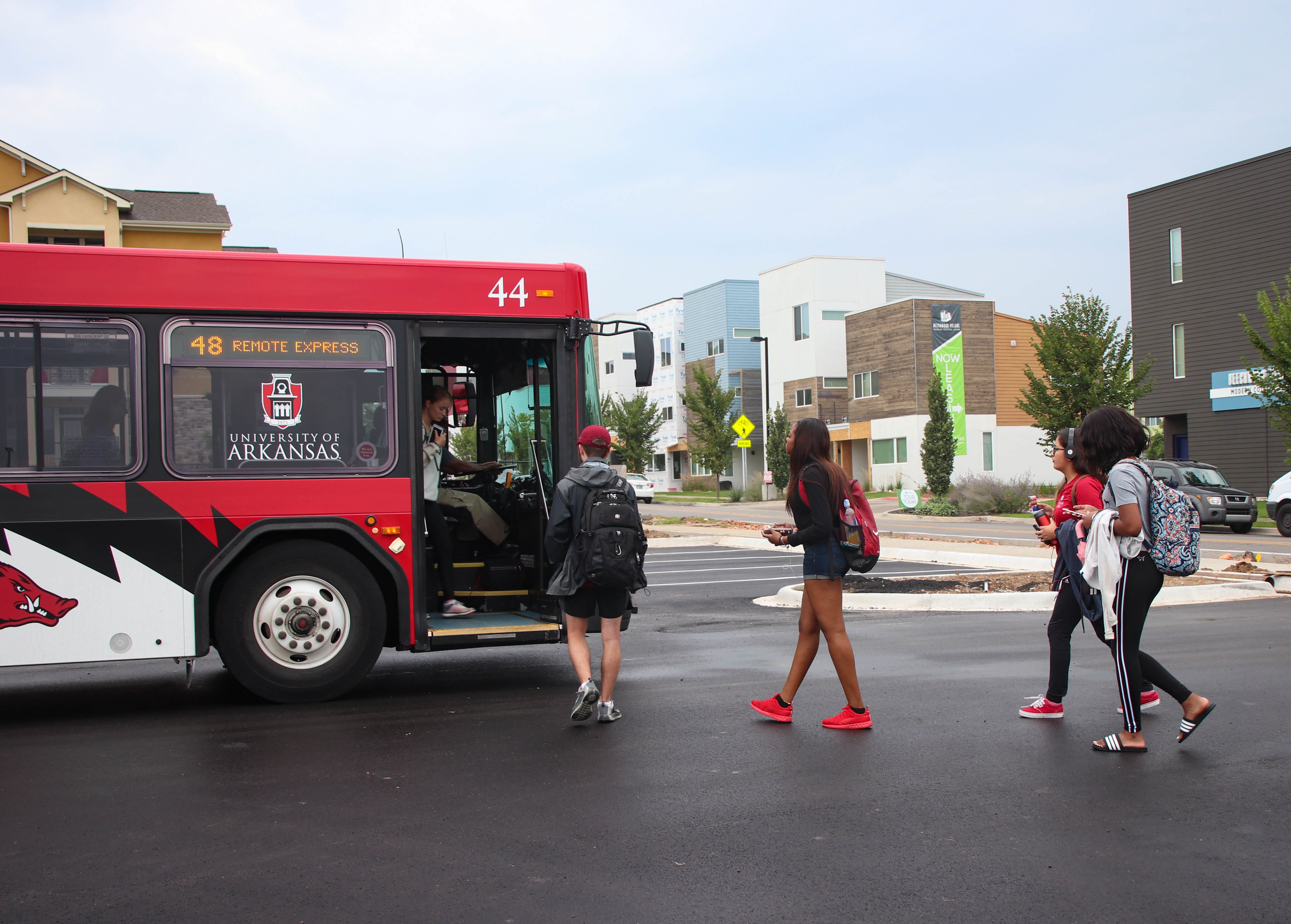 Students boarding the Route 48 Razorback Transit from Lot 99