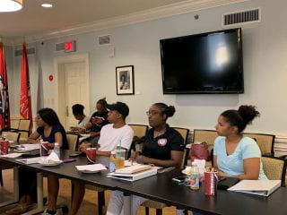 BSA and BASS Student Executive Team listen attentively at retreat.