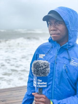 Tevin Wooten covering a storm for the Weather Channel