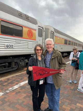 Dr. Jerry and Julie Moody showing their Arkansas spirit at the Grand Canyon Railway train station.