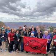 Arkansas travelers enjoying a photogenic moment at the south rim of the Grand Canyon.