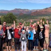 Arkansas Travelers calling the hogs atop an overlook in Sedona, Arizona.