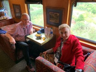 Carolyn and Jurgen Schnepel enjoying their snacks aboard the Verde Canyon Railway.