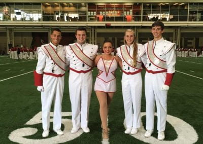 David Cox with Drum Majors Scott Lirgg, Austin Cash, and Julianne Clements, as well as Featured Twirler Savannah Miller before the last home game