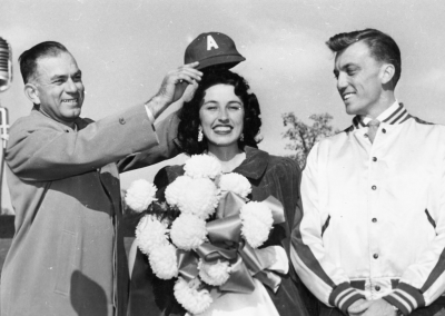 "Senator J. William Fulbright ""crowning"" homecoming queen Betty Jo Simmons in 1950 with Bob Wardlow far right"