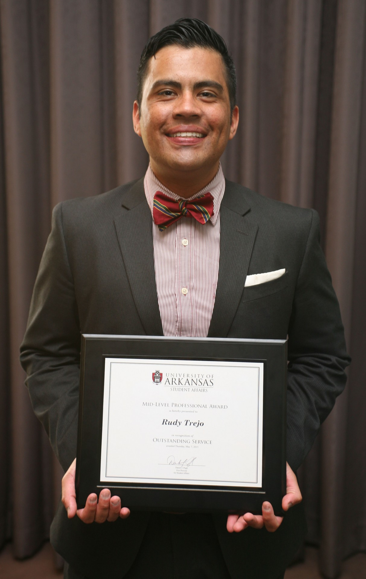 Rudy Trejo received the Outstanding Mid-Level Professional/Rising Star for 2014-2015.