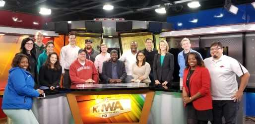 VDP Holmes, center, met with KNWA's newsroom staff.