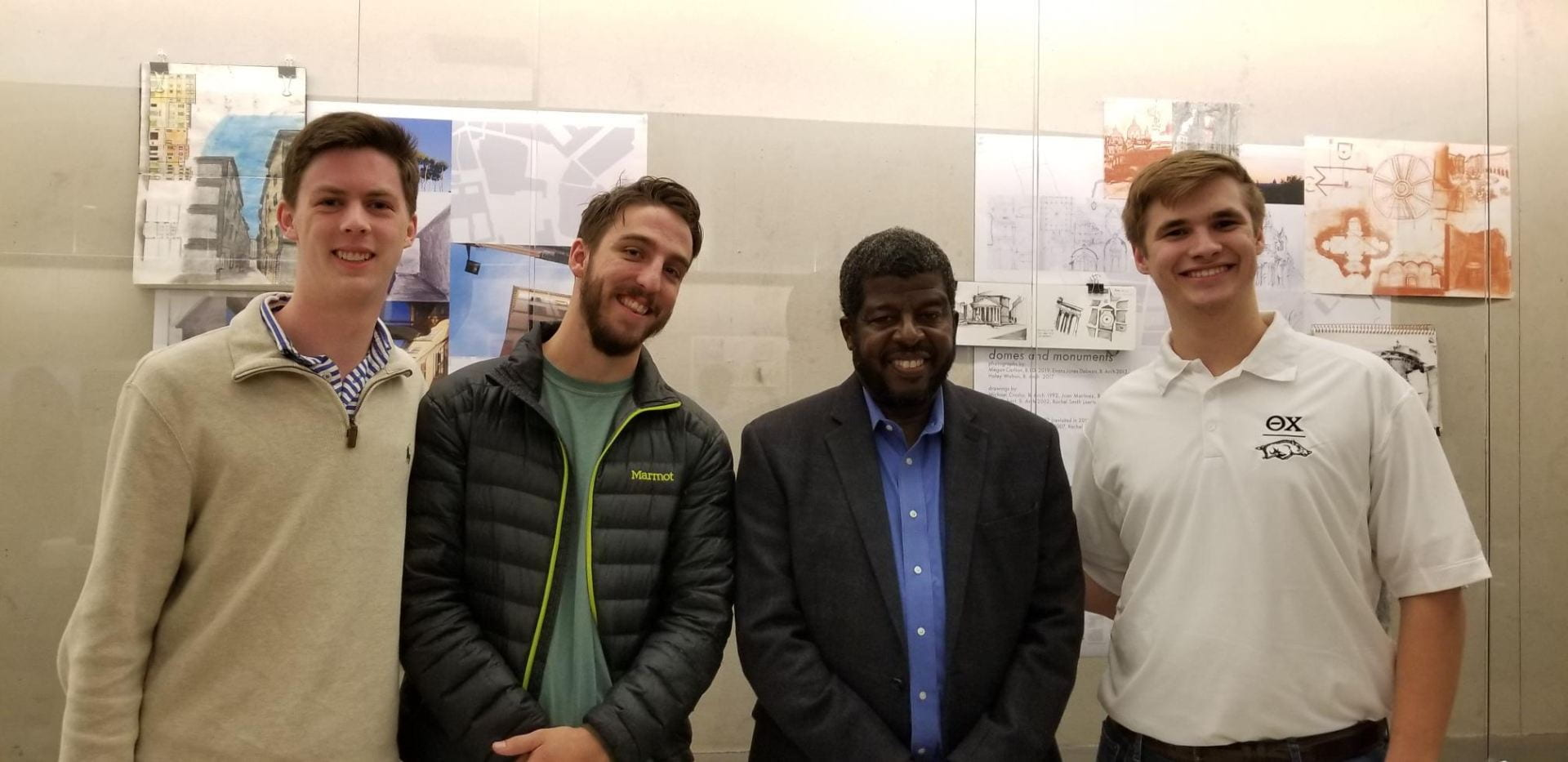 Holmes, third from left spoke with several students who attended the event including William Zurborg, Levi Brown, Prof. Holmes and Jared Pinkerton. Global Ethics Day, Oct. 2018