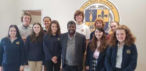 Visiting professor Holmes visited with journalism students at Haas Hall Academy Fayetteville, Oct. 2018