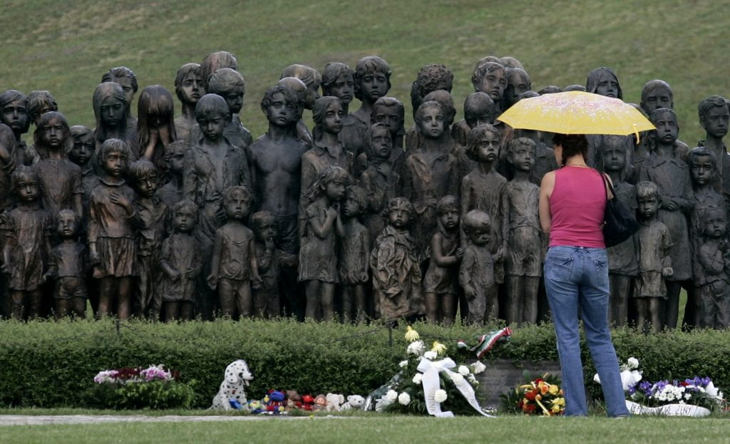 A woman stands in front of a monument to the lost children of Lidice, Czech Republic, on Sunday, June 10, 2007, during a commemoration ceremony for the victims on the 65th anniversary of the annihilation of the village in World War II. Lidice was destroyed on June 10, 1942, by Nazi troops after the assassination attempt and death of Reinhard Heydrich by Czech resistance fighters who had parachuted in from England. (AP Photo/Petr David Josek)