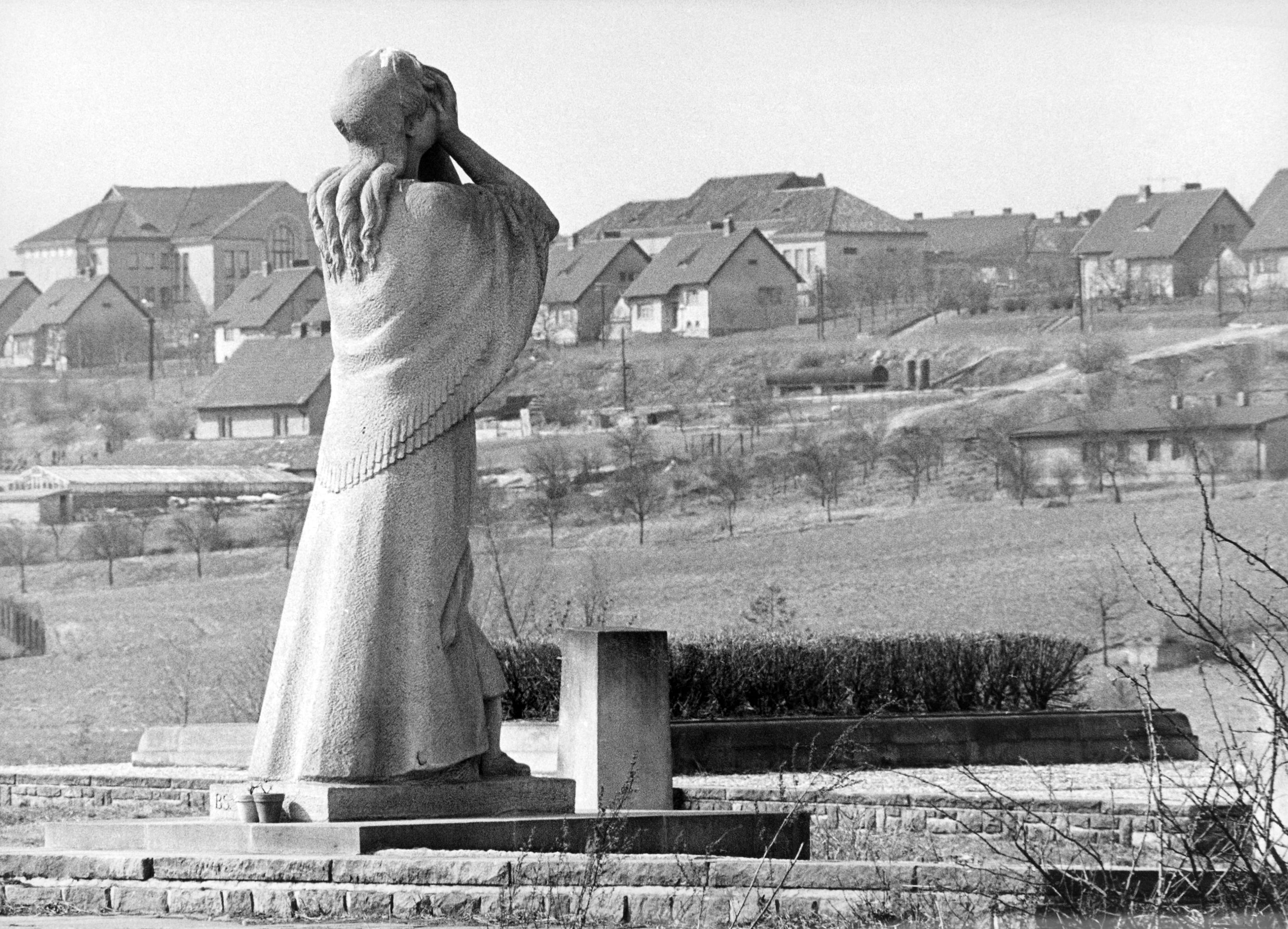 In the background is nove (new) Lidice on May 15, 1967, built after the war. In the foreground is the statue of a woman protecting her face from flames on the site of the village school, burned by Nazi troops. (AP Photo)