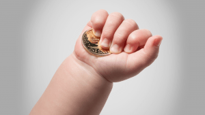 baby hand with gold coin