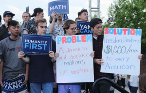 Yang supporters with signs
