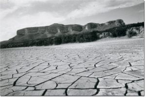 Cracked dry land during Texas 1950s drought. Photo credit.
