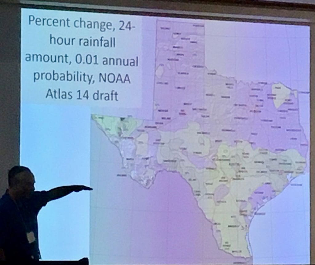 Figure 1b: John Nielsen-Gammon discusses changes in Atlas 14 in the 1 percent probability map for Texas. Areas in tan will see higher rainfall amounts for the 1-percent-chance 24-hour rainfall amount. [photo by the author].