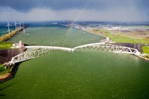 The Maeslantkering, the fifth and last storm surge barrier to be built in the Netherlands, guards the Port of Rotterdam, the busiest port in Europe.