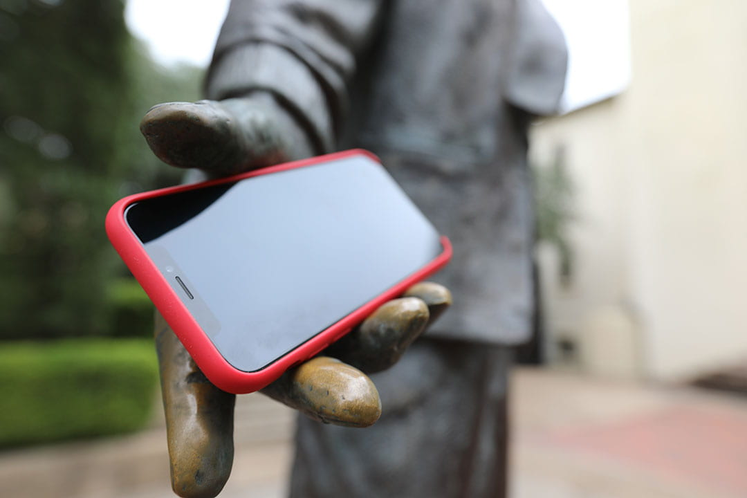 Phone in statue hand